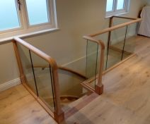 Tulipwood Staircase and Oiled Oak Glass Banister with Wall Handrail