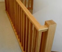 Polished Oak Staircase Revamp with Square Posts and Spindles