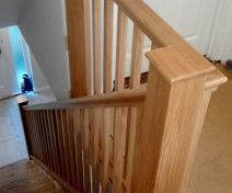 Polished Oak Staircase Revamp with Spindle Banisters and Stringer Covers