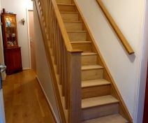Polished Oak Staircase Revamp With Wall Handrail