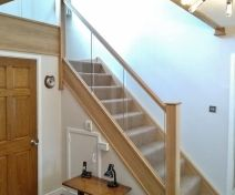 Polished Oak Staircase Revamp With Glass Banisters And Apron Covers