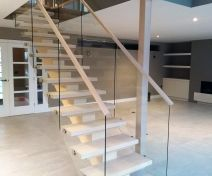 Modern Oiled Maple Staircase with Glass Banisters and Central String