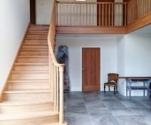 Bespoke Part Curved Polished Oak Staircase with Bullnose step, Landing Banisters and Apron Covers