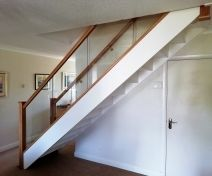 Straight Staircase with Painted Stringers, Steps, Risers and Polished Oak Glass Banister