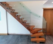 Modern Oak Staircase with Open Treads on Central Stringer with Glass Banisters and Glass Wall Handrail