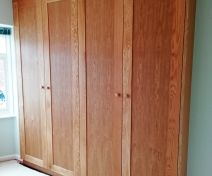 Polished Oak Wardrobe with Shaker Style Doors and Side Panels
